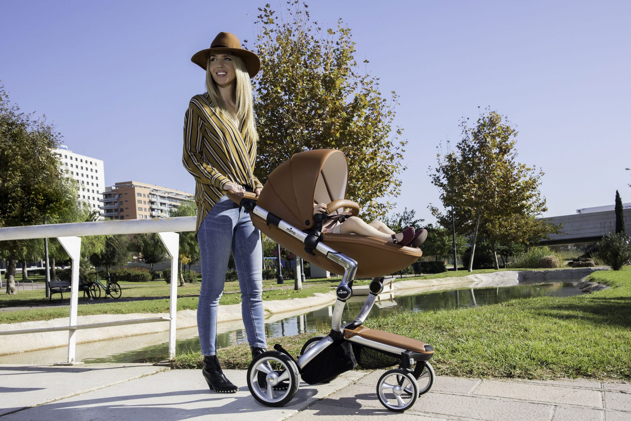 The stylish Mima Xari pram with a silver frame and camel seat