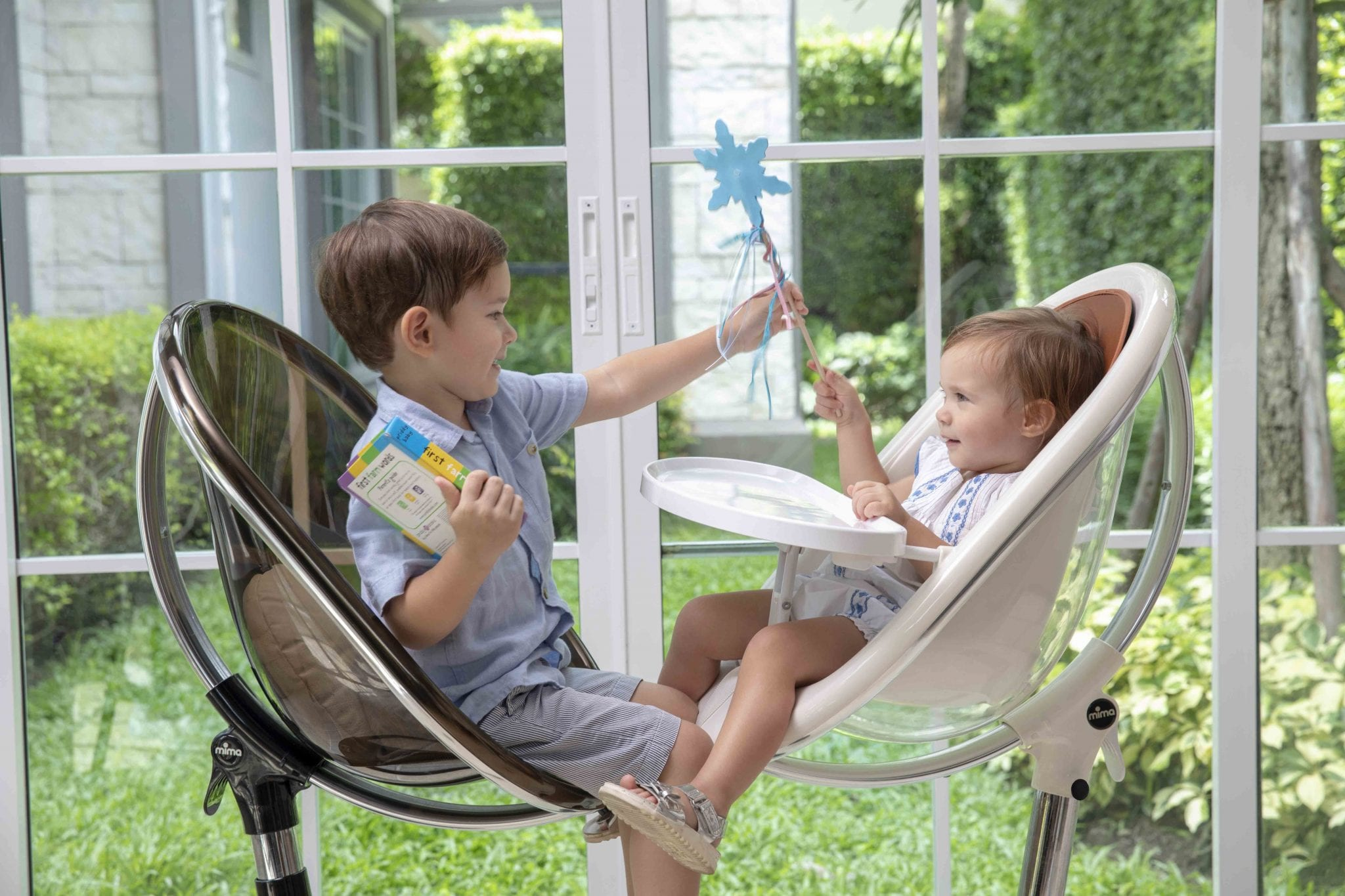 The stylish Mima Moon high chair can be used as a high chair, then it leans back, then becomes a junior chair when you're ready.
